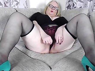 Big tits granny in slutty high heels & stockings