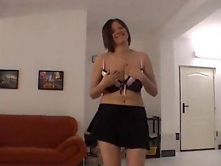 Amateur chick does striptease and shows her big boobs