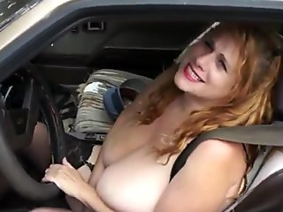 Driving down the road with her huge tits out & masturbating